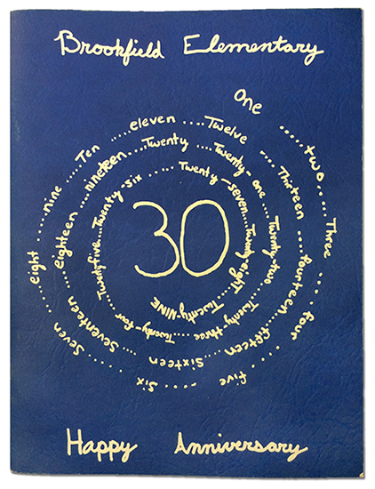 Color photograph of the cover of Brookfield's 1998 yearbook. The cover is blue with the name Brookfield, the number 30, and the words Happy Anniversary written in cursive.